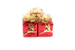Red gift box and gold Reindeer. Royalty Free Stock Photos