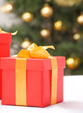 Red gift box with gold ribbon. Stock Photo