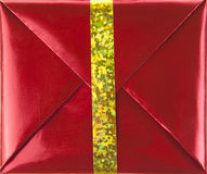 Red gift box with gold ribbon Royalty Free Stock Images