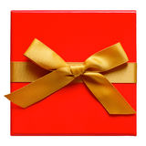 Red Gift box with gold ribbon and bow isolated on white. Royalty Free Stock Images