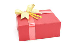 Red gift box with gold ribbon. On white background Stock Photos
