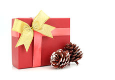 Red gift box with gold ribbon. On white background Royalty Free Stock Photography