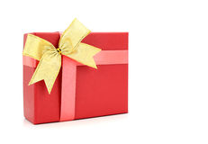 Red gift box with gold ribbon on white. Background Stock Images