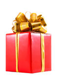 Red gift box with golden bow Stock Photography
