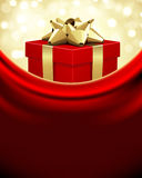 Red gift box with golden bow Royalty Free Stock Image