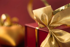 Red gift box with golden bow Royalty Free Stock Photos