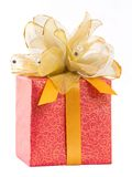 Red gift box with golden bow tie Royalty Free Stock Photography