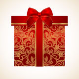 Red gift box with golden pattern, bow, ribbon