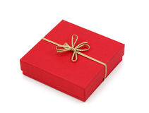 Red gift box with golden ribbon Stock Photos