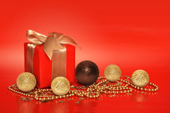 Red gift box with golden ribbon Royalty Free Stock Photo