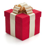 Red gift box with golden ribbon. royalty free stock photos