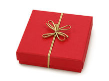 Red gift box with golden ribbon Royalty Free Stock Photos