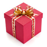 Red gift box with golden ribbon and bow. Royalty Free Stock Photos