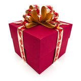 Red gift box with golden ribbon and bow. stock photo