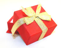 Red gift box. With golden ribbon on white background stock image