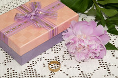 Red gift box with golden ring and peony Stock Photo