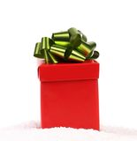 Red gift box with green-golden bow. Stock Photo