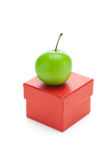 Red gift box and green plum Royalty Free Stock Image