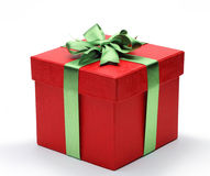 Red gift box with green ribbon bow Royalty Free Stock Photography