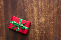 Red gift box with green ribbon with polka dots Royalty Free Stock Images