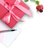 Red gift box with greeting card Stock Photos