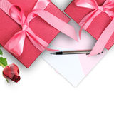 Red gift box with greeting card Royalty Free Stock Photo