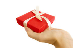 Red gift box in hand. Isolated on white Stock Photo
