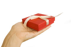 Red gift box in hand Stock Photo