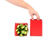 Red gift box with a hand on it. Royalty Free Stock Photography