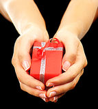 Red gift box with hands Royalty Free Stock Photos