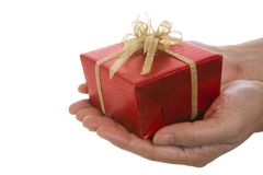Red gift box on hands over the white background Royalty Free Stock Photo
