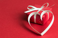 Red gift box with a heart shape symbol Stock Photography
