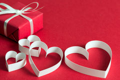 Red gift box with heart shape symbol Stock Photography