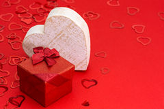 Red gift box with heart Stock Images