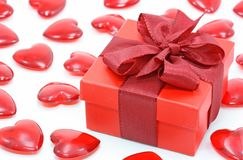 Red gift box and hearts Stock Photography