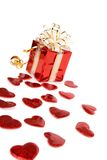 Red gift box and hearts isolated on white Royalty Free Stock Images
