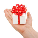 Red gift box in his hands Royalty Free Stock Photos