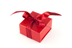 Red gift box, isolated. Red luxury gift box with red ribbon, isolated on white Royalty Free Stock Photos