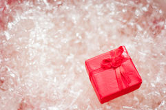 Red gift box. Red jewelry box on plastic wrappings Royalty Free Stock Images