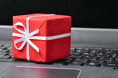 Red gift box on a keyboard Stock Images