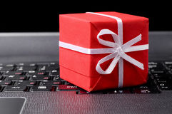 Red gift box on a keyboard Stock Photo