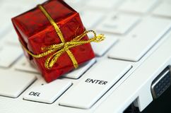 Red gift-box on a keyboard Stock Images