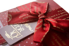 Red gift box for a loved one. Red gift box with a ribbon for a loved one who is always on our mind royalty free stock photos