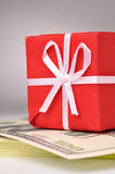Red gift box on money Royalty Free Stock Photos