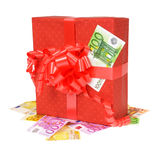 Red gift box with money Royalty Free Stock Images