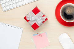Red gift box on office table Stock Images