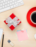 Red gift box on office table Stock Photo