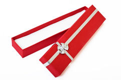 Red gift box open cutout. Red gift box open empty decorated with silver ribbon over white Wwth clipping path. Put any object or present in Stock Images