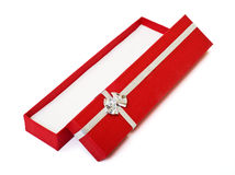Red gift box open cutout. Red gift box open empty decorated with silver ribbon on white with clipping path. Put any object or present in it Stock Images