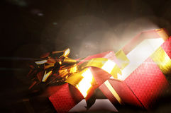 Red gift box open with glow in the dark Royalty Free Stock Image